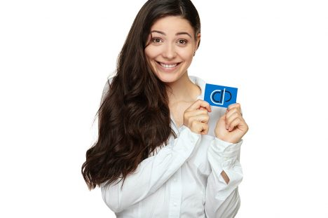 Showing woman presenting blank gift card sign. Isolated on white background.